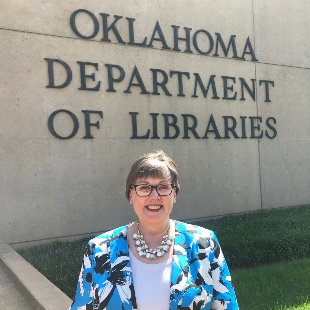 Photo of Susan McVey outside the Allen Wright Memorial Library, headquarters for the Oklahoma Department of Libraries.